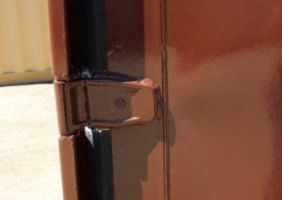 Feature Project Brown Paint close up image of door hinge